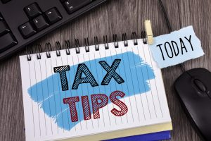 Text sign showing Tax Tips