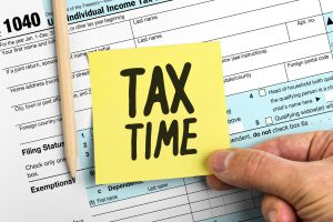 Yellow Paper Note With Words Tax Time